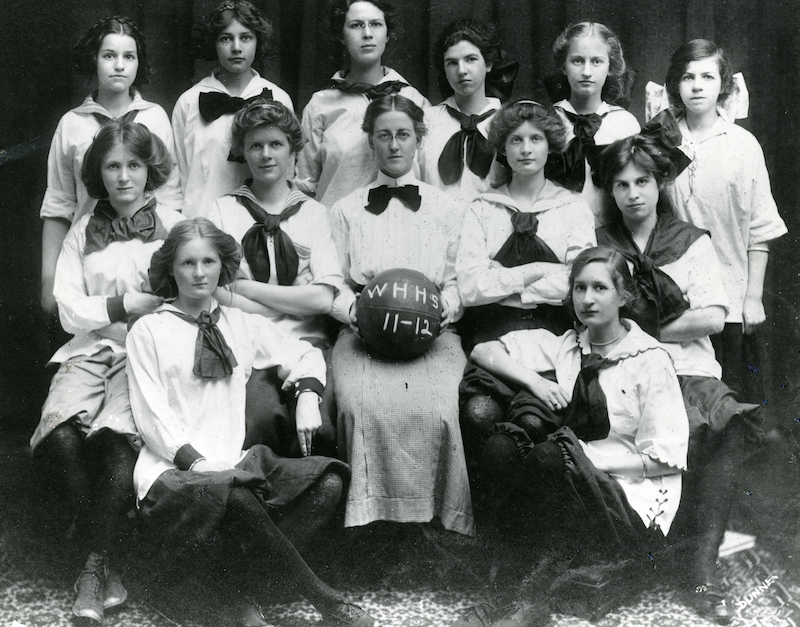 Coach Louise Duffy sits with her West Hartford High School girls' basketball team in 1911-12. Source: Noah Webster House & West Hartford Historical Society.
